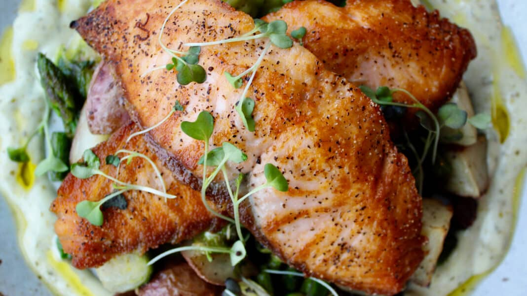 The popular Pan-Roasted Salmon has remained a menu mainstay for more than a year.