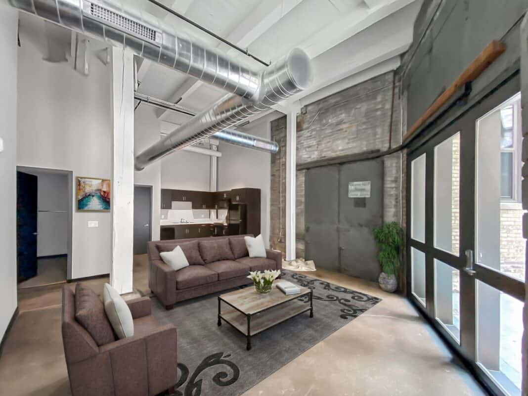 All of Gold Medal Lofts' apartment units feature exposed brick and high ceilings. Photo courtesy of J. Jeffers & Co.