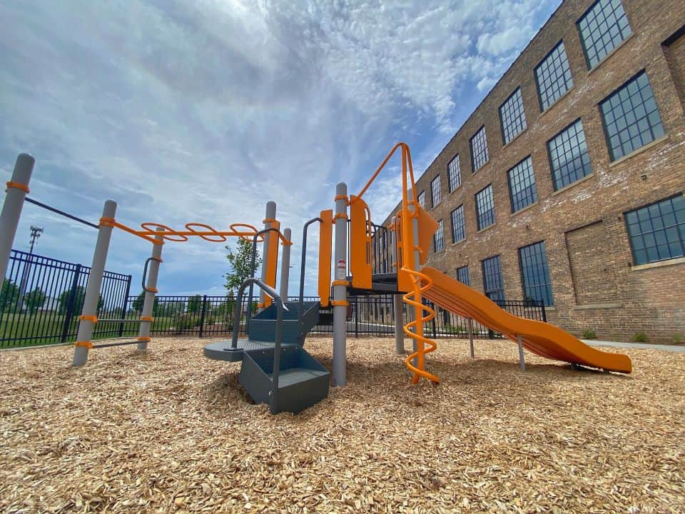 Fenced-in playground at Gold Medal Lofts. Photo courtesy of J. Jeffers & Co.