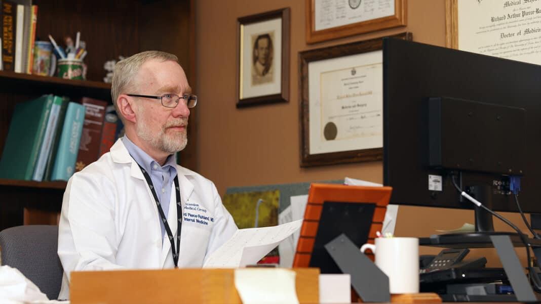 Dr. Richard Pierce-Ruhland, internal medicine physician at Ascension All Saints at Spring Street in Racine, conducts a virtual visit.