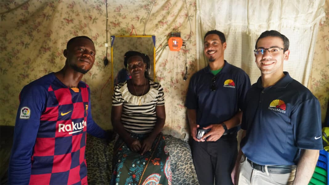 Aaron Olson and Mehrdad Arjmand visited a house in Kinshasa to install a NovoMoto solar power kit.