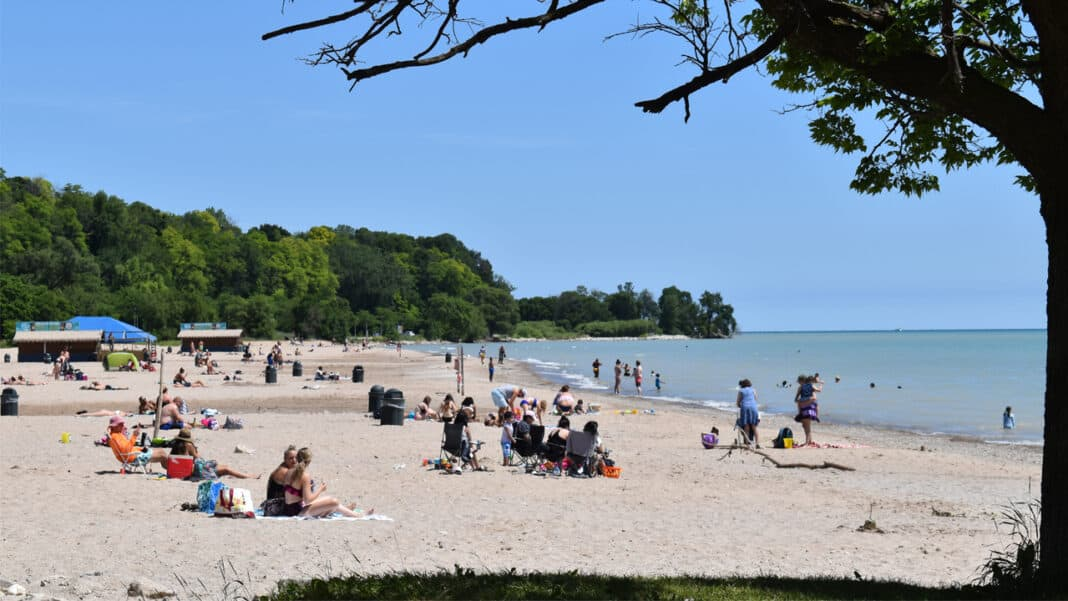 Health officials have encouraged visitors at Bradford Beach to spread out and wear masks to mitigate the spread of the coronavirus.
