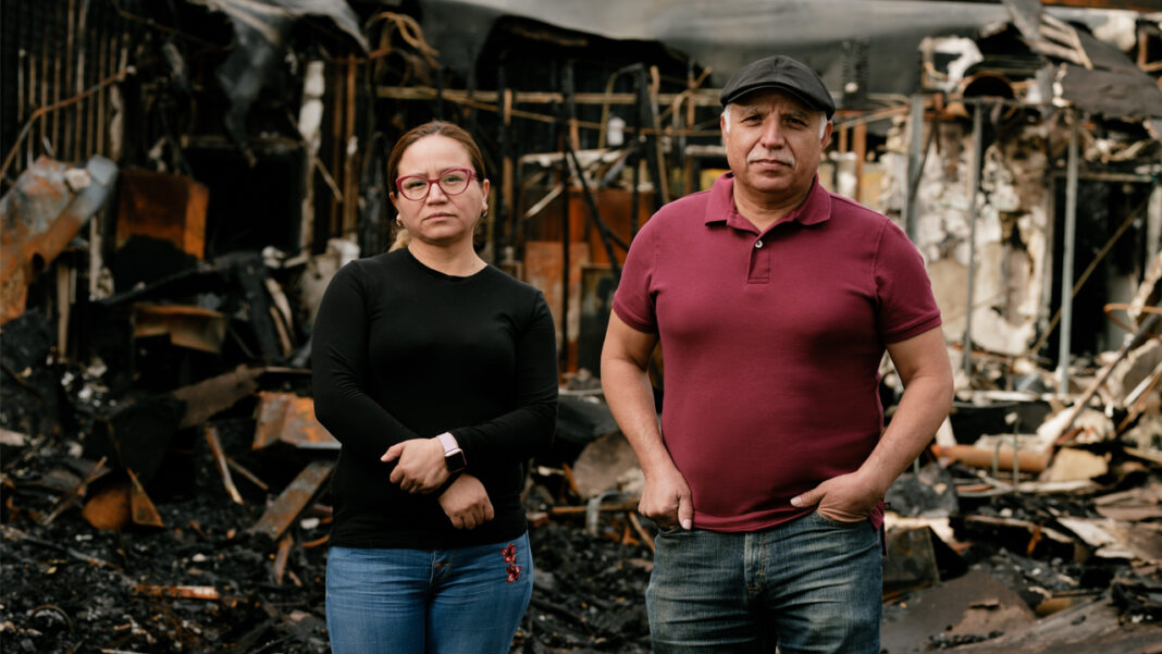 La Estrella Supermarket owner Abel Alejo and Uptown Restaurant owner Yolanda Hernandez owned their businesses for nearly six years before the civil unrest left most of their block in a pile of rubble. Here, Alejo and Hernandez stand inside the middle of the building where their businesses are located on the 6000 block of 22nd Avenue.