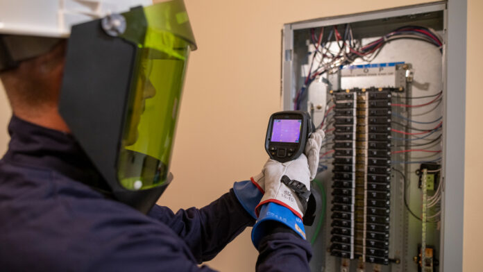Service Electrician Sean McFadyen performing Infrared(IR) Scanning on an electrical panel.