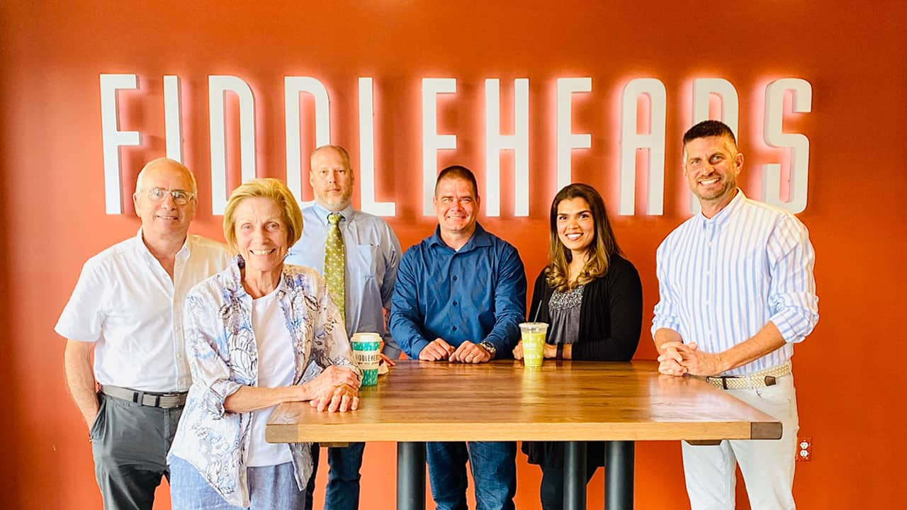 Fiddleheads current owners (left to right) Ray Marcy, Loreen Marcy, Steve Klimczak, R.J. Marcy, Mahnaz Marcy and Mike Wroblewski.