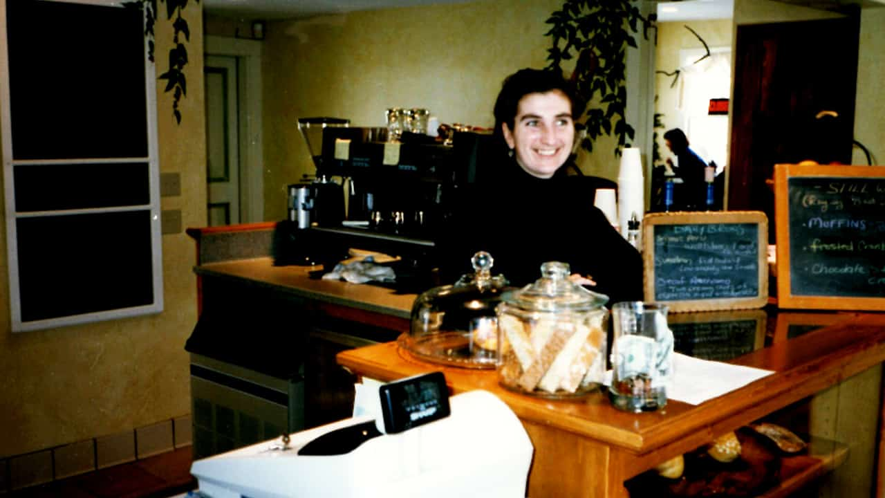 Lynn Wroblewski stands behind the counter at Fiddleheads' first location, in Thiensville, on opening day December 1996.